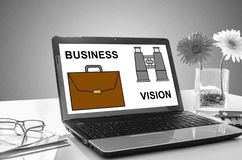 Business vision concept on a laptop screen. Laptop screen showing business vision concept stock photos