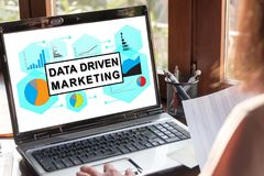 Data driven marketing concept on a laptop screen. Laptop screen showing data driven marketing concept stock images