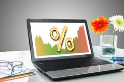 Interest rates concept on a laptop screen. Laptop screen showing interest rates concept Stock Photo