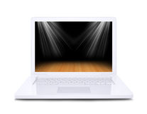 On the laptop screen shows wooden floor floodlit. White background royalty free stock image