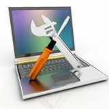 Laptop with screwdriver and wrench Royalty Free Stock Images