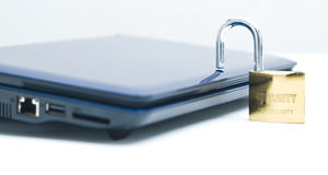 Laptop and security locker Stock Photo