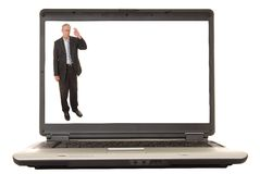 Laptop Senior Executive. Laptop computer with a senior executive on the screen Stock Photo
