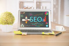 Laptop with SEO sketch Stock Images