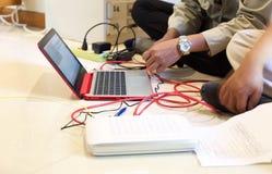 Laptop set up a fiber optic telecomunication link Royalty Free Stock Photos