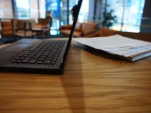 A side view of an open laptop on a table Stock Images