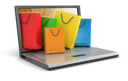 Laptop and Shopping Bags (clipping path included) Stock Photos