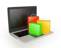 Laptop with shopping bags Royalty Free Stock Image