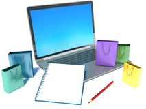 Laptop with shopping bags and notebook Royalty Free Stock Photo