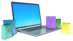 Laptop with shopping bags Stock Photography