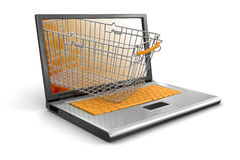 Laptop and Shopping Basket (clipping path included) Stock Images