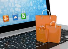 Laptop and  shopping pags Stock Images