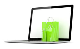 Laptop and  shopping pags on white Stock Images