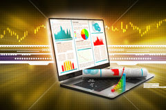 Laptop showing a financial report Stock Photography