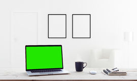 Laptop showing green screen in home interior background. Laptop computer showing green screen in home interior background Stock Images