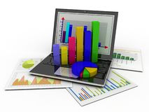 Laptop showing a spreadsheet and a paper Stock Image