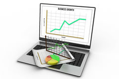 Laptop showing a spreadsheet and a paper Royalty Free Stock Photos