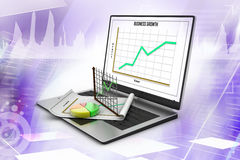 Laptop showing a spreadsheet and  statistic charts Royalty Free Stock Photos