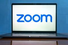 Laptop showing Zoom Cloud Meetings app logo.