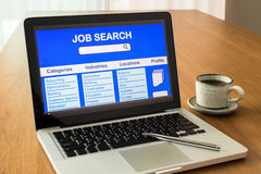 Laptop shows user interface of online job search Stock Images