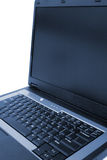 Laptop Side View. Side view of a laptop isolated over white Royalty Free Stock Photo