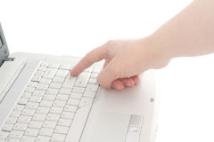 The laptop a side view a female hand touch on keys. Isolated object Stock Images
