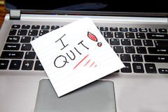 Laptop with sign laying on it, I quit! Royalty Free Stock Images