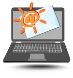 Laptop with at sign stylized as sun and mailing envelope Stock Photo
