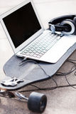 Laptop on skateboard Royalty Free Stock Images