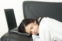 laptop sleeping woman Στοκ Φωτογραφίες