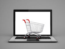 Laptop with small shopping cart Stock Image