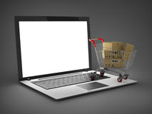 Laptop with small shopping cart Stock Photos