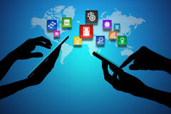 Laptop and Smart Phone around World Globe Stock Photo