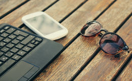Laptop with smart phone Royalty Free Stock Photography