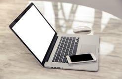Laptop with smart phone Stock Photos