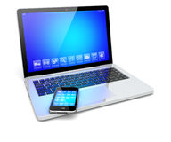 Laptop and smartphone with blue screen Stock Photos