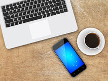 Laptop, smartphone and coffee on a desk Stock Photography