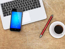 Laptop, smartphone and coffee on a desk Royalty Free Stock Image