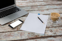 Laptop with smartphone and cup of coffee Royalty Free Stock Image