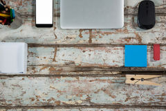 Laptop, smartphone and mouse with office accessories Royalty Free Stock Photography