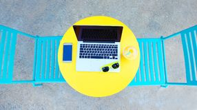 laptop, smartphone and sunglasses on the table Stock Photography