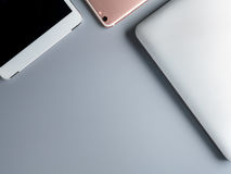 Laptop, smartphone and tablet on gray background stock photo