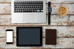 Laptop, smartwatch, smartphone and digital tablet with cup of coffee Stock Photo