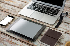 Laptop with smartwatch, smartphone, digital tablet and organiser. On wooden table Stock Photography