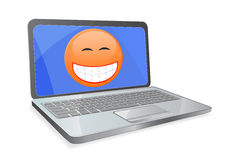 Laptop with smile on screen Stock Photos