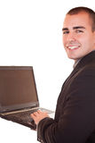 Laptop and smiling businessman Royalty Free Stock Image