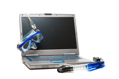 Laptop and snorkeling Royalty Free Stock Photos