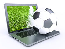 Laptop with soccer football ball Stock Images