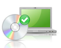Laptop and Software Disk Royalty Free Stock Photos