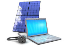Laptop and solar panel Stock Photo
